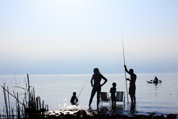 Family in a camping trip fishing. Camping with kids advice