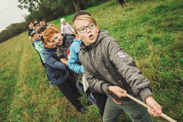 Kids playing camping games. Camping with kids tips