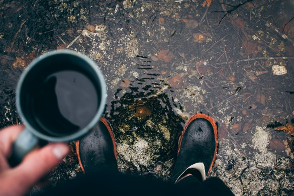 Camping trip. Rain boots and coffe