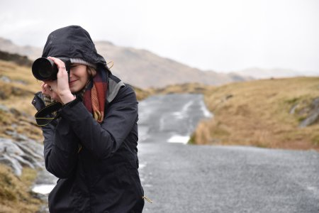 Girl taking picture of cold landscape